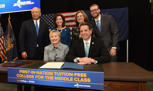 Governor Cuomo alongside Secretary Hillary Clinton signs legislation enacting the Excelsior Scholarship Program.